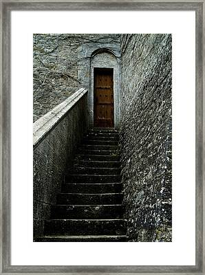 Narrow Stairway To A Wooden Door Framed Print by Todd Gipstein
