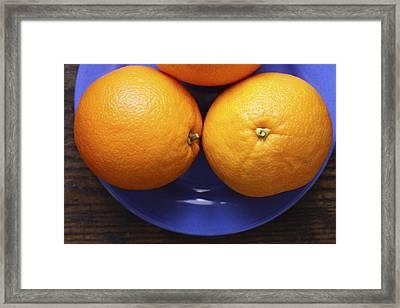 Naval Oranges On Blue Plate Framed Print by Donald Erickson