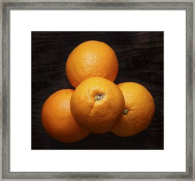 Naval Oranges On Wood Background Framed Print by Donald Erickson