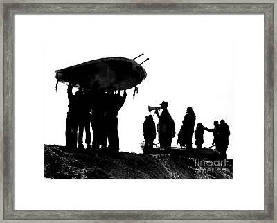 Navy Seals Hold An Inflatable Boat Framed Print