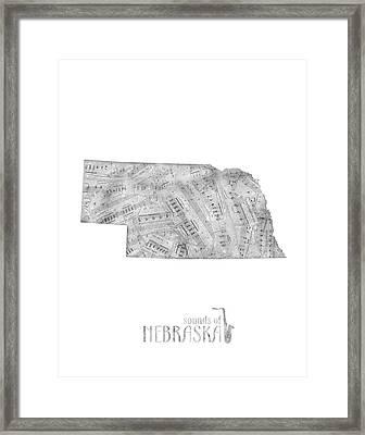 Nebraska Map Music Notes Framed Print