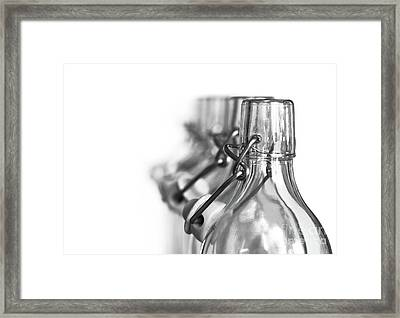 Neck Of Glass Bottles With A Porcelain Stopper Framed Print by Michal Boubin