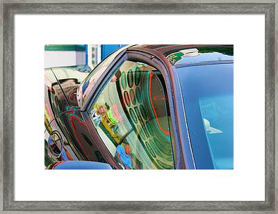 Neon Reflections On A Black Car Framed Print