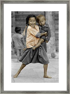 Nepali Girl And Baby Brother - Kathmandu Framed Print by Craig Lovell