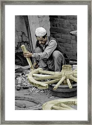 Nepali Wood Carver Framed Print by Craig Lovell