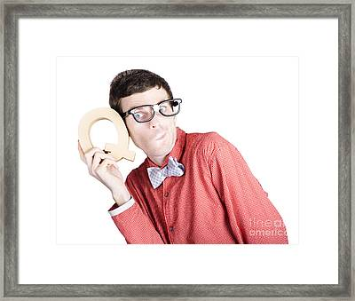 Nerd Businessman Holding Letter Q For Question Framed Print by Jorgo Photography - Wall Art Gallery