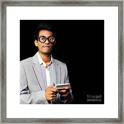 Nerd Playing Handheld Video Game Framed Print by Jorgo Photography - Wall Art Gallery