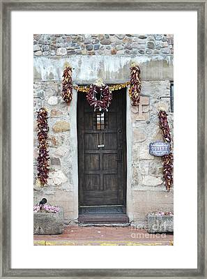 Framed Print featuring the photograph New Mexico Red Chili Ristras Door by Andrea Hazel Ihlefeld