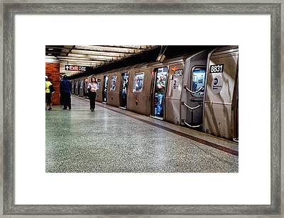 Framed Print featuring the photograph New York City Subway Stare by Lars Lentz