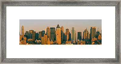 New York Skyline At Sunset Framed Print by Panoramic Images