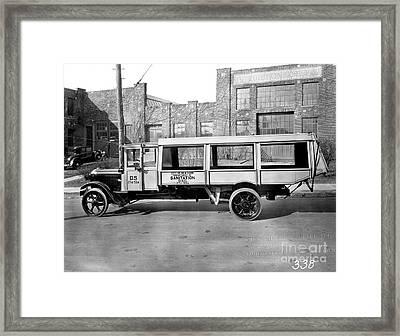 New York Trash Truck Framed Print by Jon Neidert