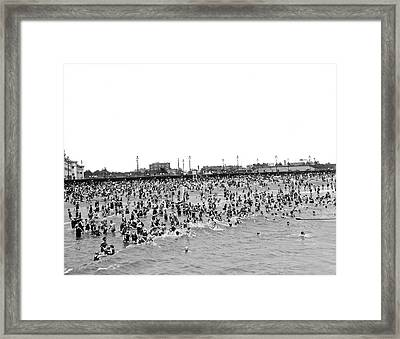 New Yorkers At Coney Island. Framed Print
