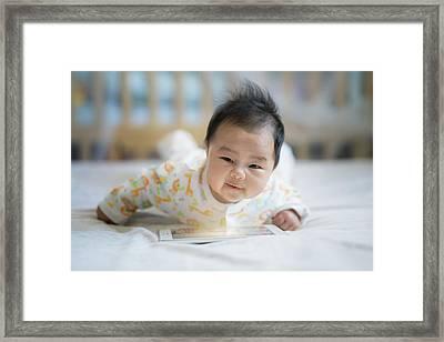Newborn Baby Listen Song From Smart Phone Framed Print