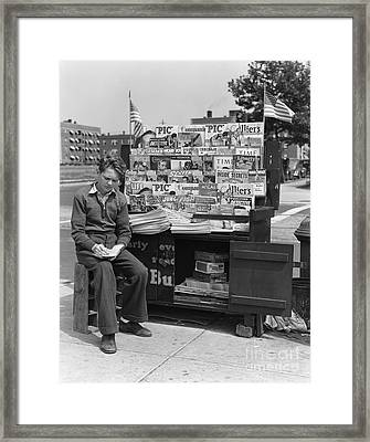 News Boy Writing On Notepad, 1940s Framed Print by H. Armstrong Roberts/ClassicStock