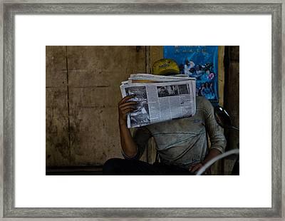 News Break Framed Print