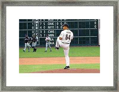 Nieve Pitching Framed Print by Teresa Blanton