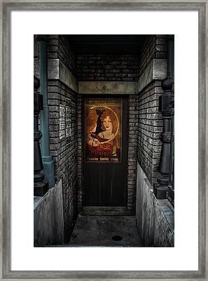 Nightlife Behind Secret Doors Framed Print by Luis Rosario