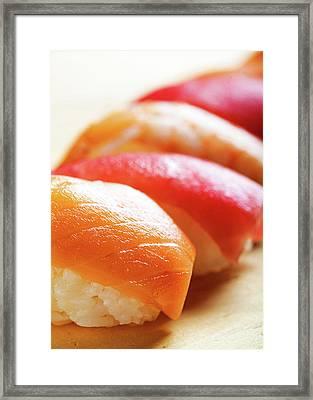 Nigiri Sushi On Wood - Vertical Framed Print by Susan Schmitz
