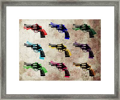 Nine Revolvers Framed Print by Michael Tompsett