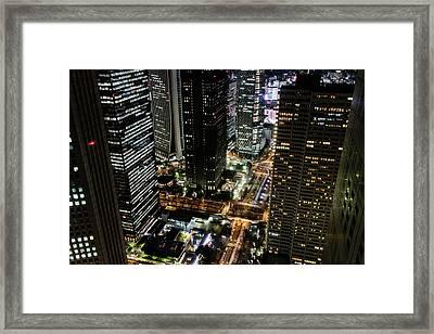 Nishi Shinjuku At Night Framed Print by Peter Austin