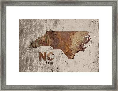North Carolina State Map Industrial Rusted Metal On Cement Wall With Founding Date Series 022 Framed Print by Design Turnpike