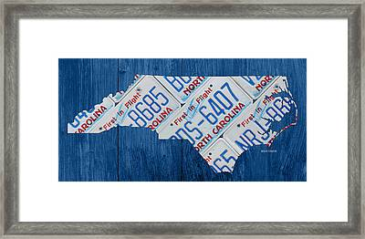 North Carolina Vintage Recycled License Plate Map On Blue Wood Plank Background Framed Print by Design Turnpike