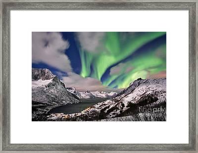 Northern Lights Over Winter Landscape Framed Print