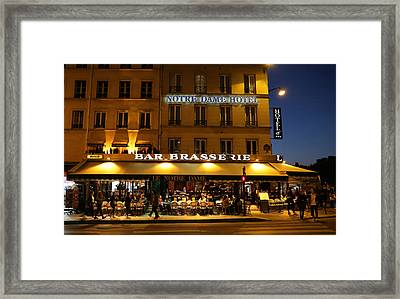 Framed Print featuring the photograph Notre Dame Cafe by Andrew Fare