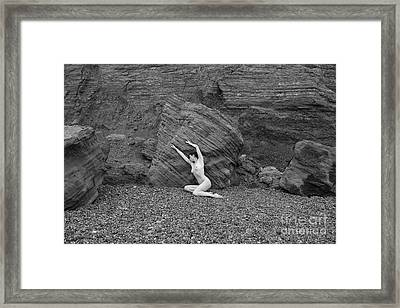 Nude Woman Pulling Shape By Rocks Framed Print