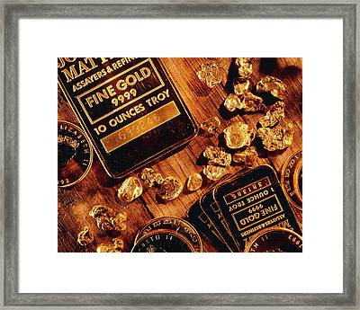 Nuggets, Bars And Coins Made Of Gold Framed Print by David Nunuk