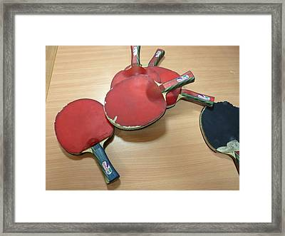 Number Of Ping Pong Bats Piled On A Table Framed Print