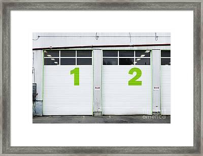 Numbers On Repair Shop Bay Doors Framed Print