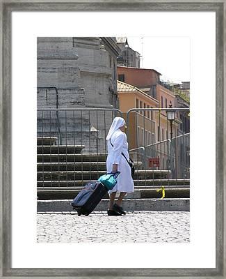 Nun Dragging Her Suitcase Framed Print by Shirley Stevenson Wallis