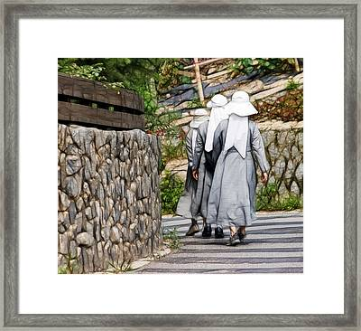 Framed Print featuring the photograph Nuns In A Row by Cameron Wood