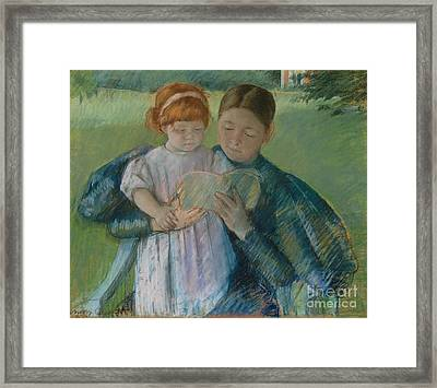 Nurse Reading To A Little Girl Framed Print