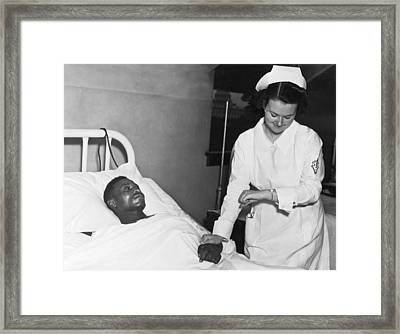 Nurse Taking Man's Pulse Framed Print