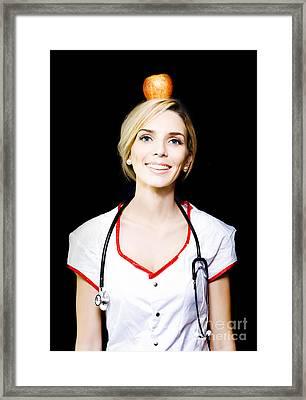 Nurse With The Concept Of A Healthy Balanced Diet Framed Print by Jorgo Photography - Wall Art Gallery