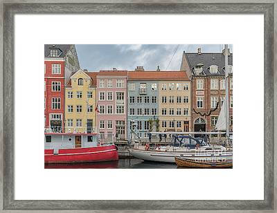 Framed Print featuring the photograph Nyhavn Waterfront In Copenhagen by Antony McAulay