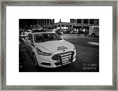 nypd ford fusion police cruiser parked on the street at night New York City USA Framed Print