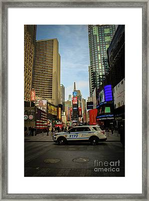 Nypd In Times Square Framed Print