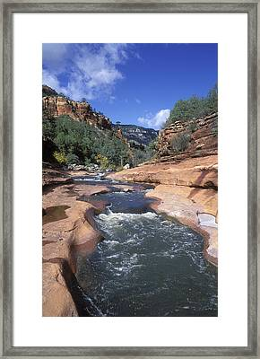 Oak Creek Flowing Through The Red Rocks Framed Print by Rich Reid