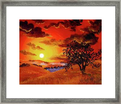 Oak Tree In Red Sunset Framed Print by Laura Iverson