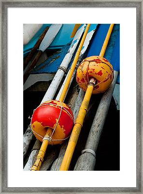Oars And Bouys Manarola Italy Framed Print by Xavier Cardell