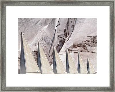 Obelisks Aligned Framed Print by Ron Bissett