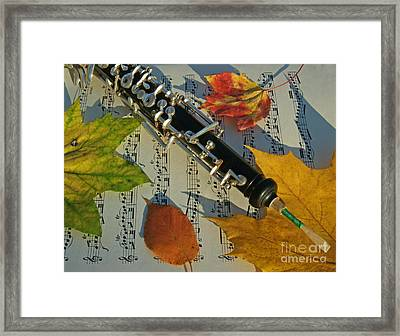Oboe And Sheet Music On Autumn Afternoon Framed Print