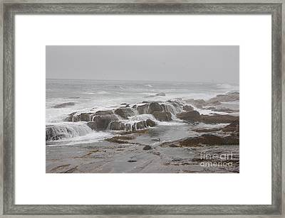 Ocean Waves Over Rocks Framed Print