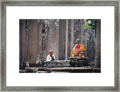 Offerings Made To Buddha At Angkor Wat Framed Print by Steve Raymer
