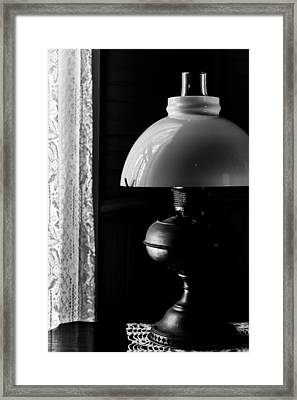 Oil Lamp On Table Framed Print