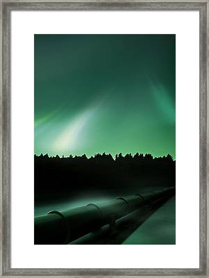 Oil Pipeline And Aurora Framed Print