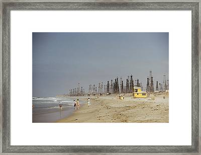 Oil Rigs Line Huntington Beach Framed Print by J Baylor Roberts